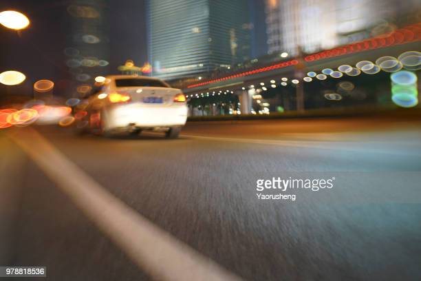 car moving fast in modern city night,shanghai,china