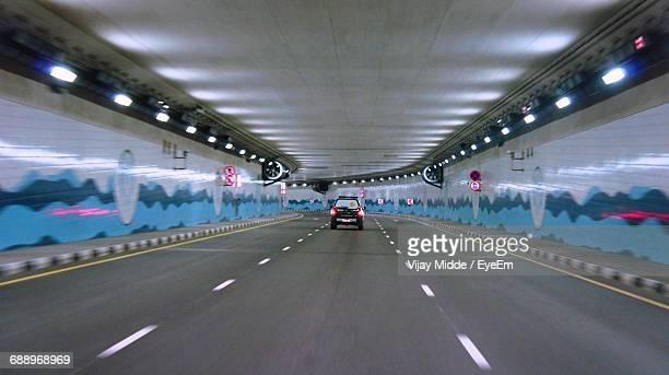 Car Moving In Illuminated Tunnel