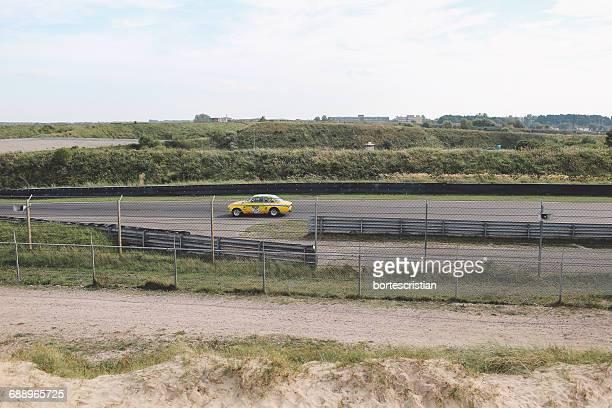 car moving on race track - racerbana bildbanksfoton och bilder