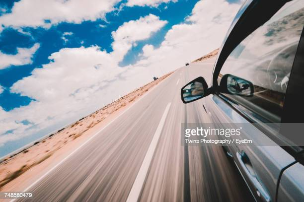 Car Moving On Road Against Sky