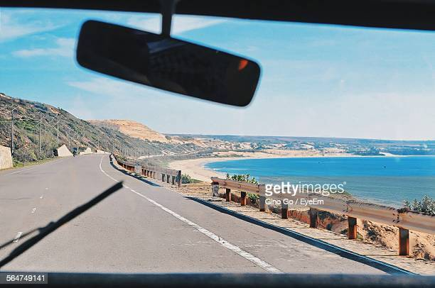 Car Moving On Road Surrounded By Sea