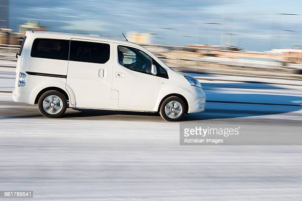 Car moving on snow covered street