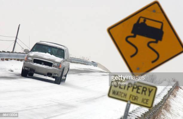 A car navigates down an icy road December 9 2005 in Toledo Ohio Seven inches of snow fell over night marking the first significant snow fall of the...