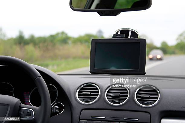 car navigation system (GPS) mounted in car on windshield
