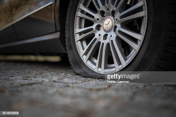A car of Mercedes with its flat tire is pictured on February 25 2018 in Berlin Germany