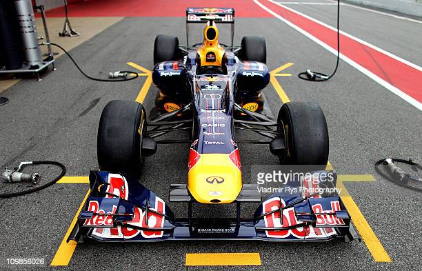 Car of Sebastian Vettel of Germany and Red Bull Racing is pictured on the pit lane during the Formula One testing at Circuit de Catalunya on March 8...