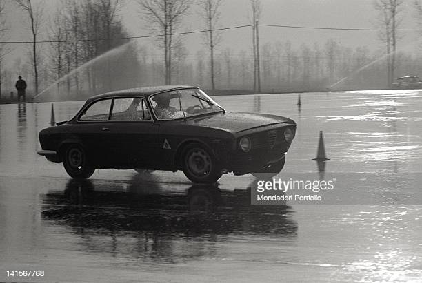 A car of the Alfa Romeo Italian car company being tested on the Balocco trial track Balocco