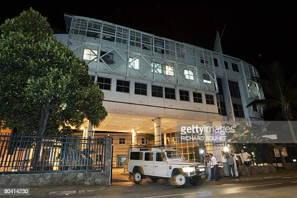A car of the ousted rebel leader of the Comoros island of Anjouan Mohamed Bacar's escort leaves the police station on March 27 2008 in Saint Denis on...