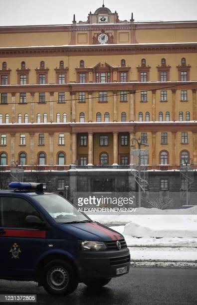 Car of the Russian Investigative Committee drives past the headquarters of the Federal Security Service , the successor agency to the KGB, and...