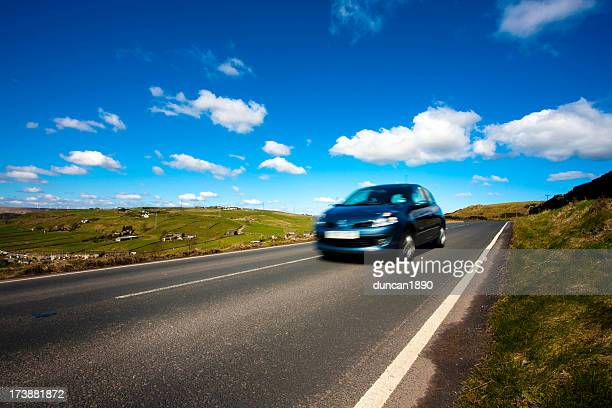 car on a country road - rushing the field stock pictures, royalty-free photos & images