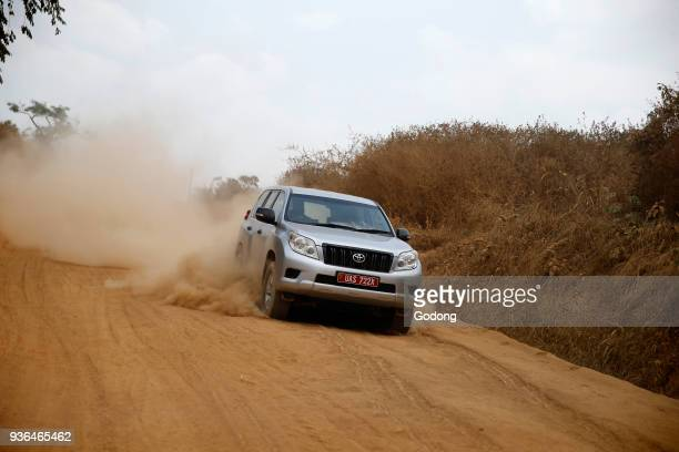 Car on a dusty African road Uganda