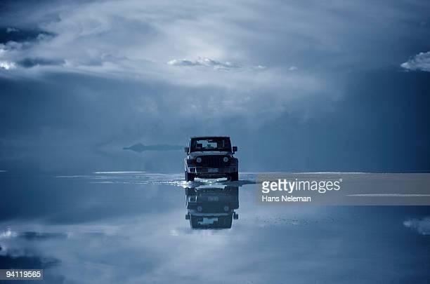 Car on a frozen lake, Salar De Uyuni, Altiplano, Bolivia