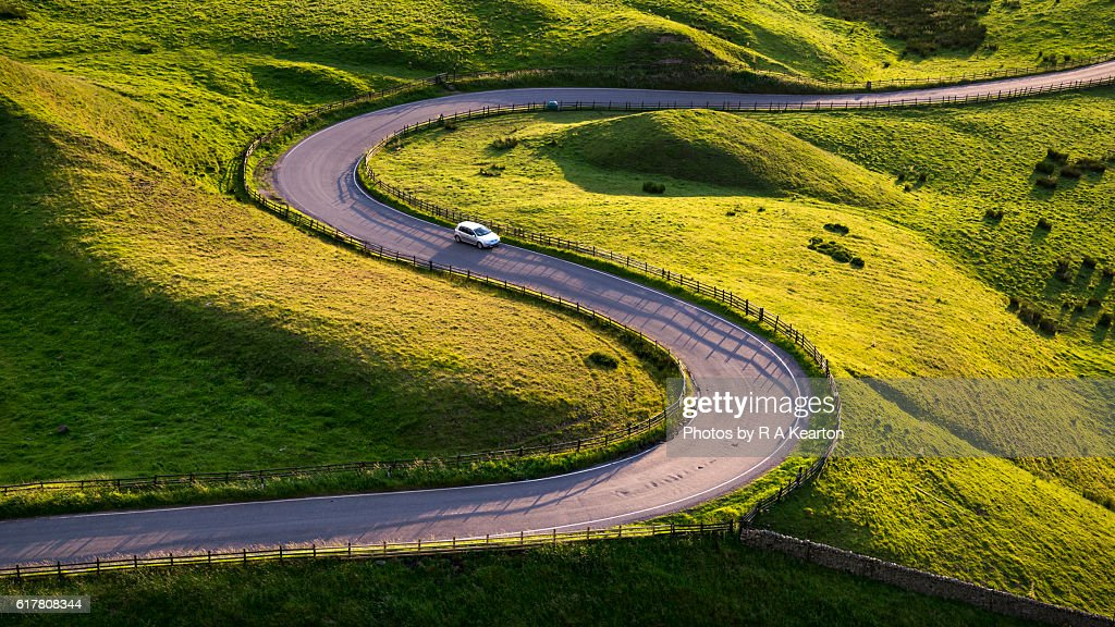 Car on a twisty, winding road : Stock Photo