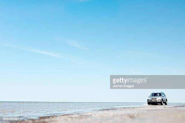 car on beach - land vehicle stock pictures, royalty-free photos & images