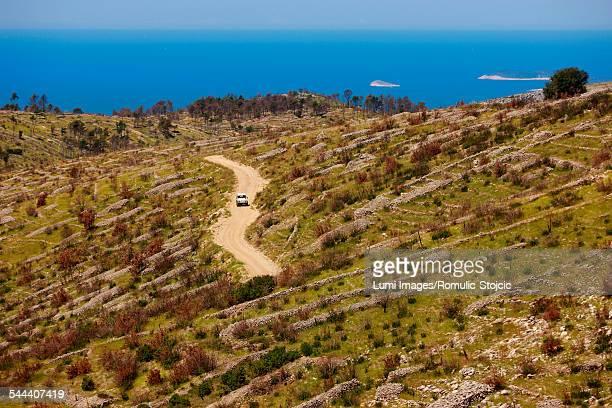 Car on dirt road, Hvar island, Dalmatia, Croatia