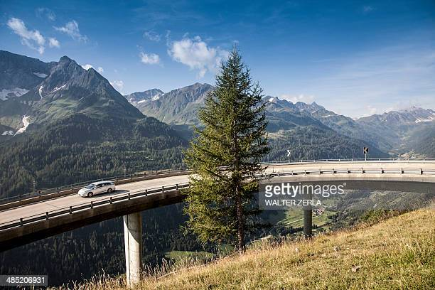 Car on elevated highway to Gotthard Pass, Switzerland
