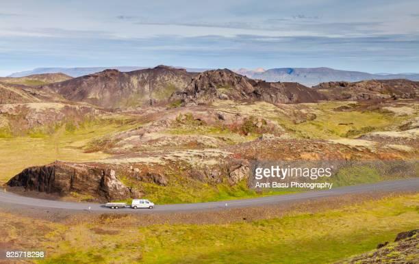 Car on empty road, Thingvellir National Park, Iceland