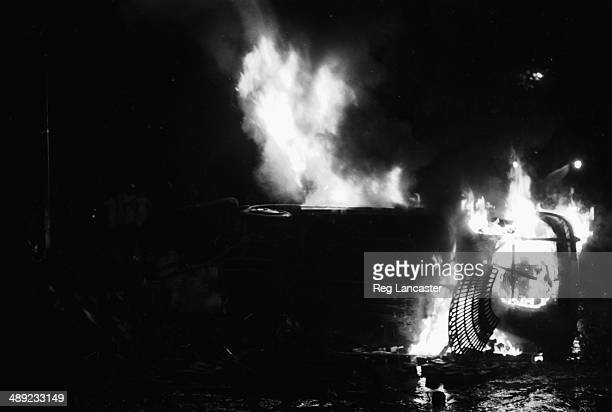 A car on fire in Paris during the riots France 25th May 1968