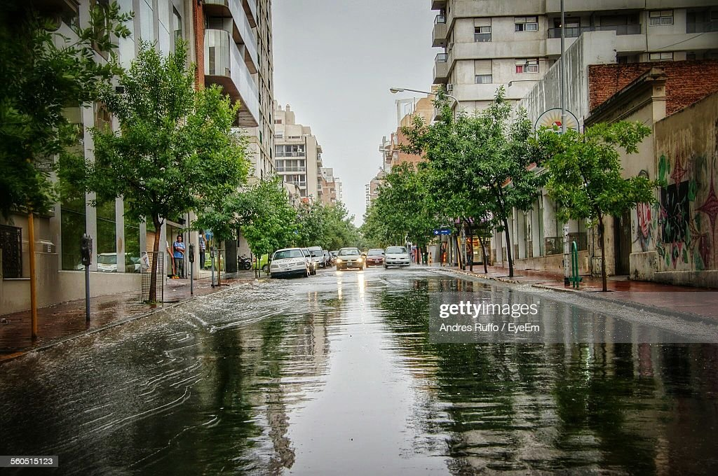 Car On Flooded Road In City : Stock Photo