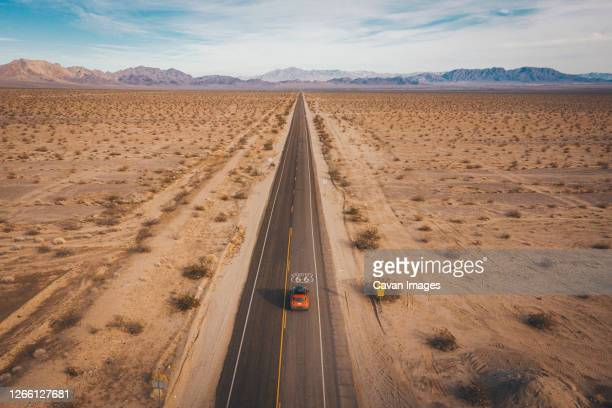 a car on highway 66 from above, california - route 66 stock-fotos und bilder