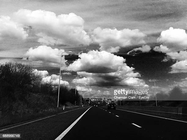 Car On Highway Against Cloudy Sky