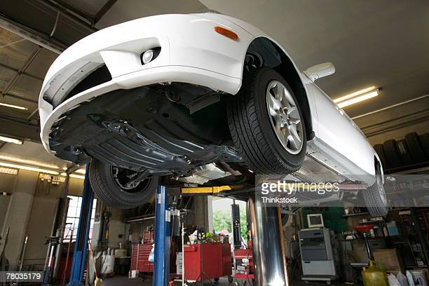 Car on lift in auto mechanic shop