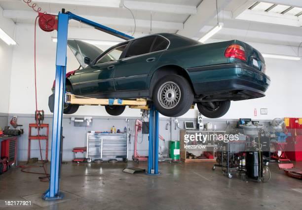 Car on Lift in Auto Repair Garage