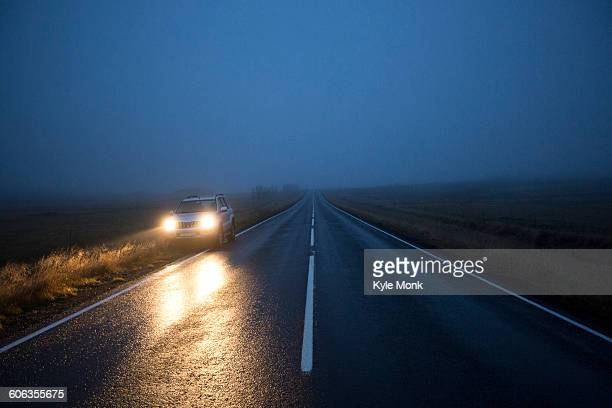 Car on remote road at night