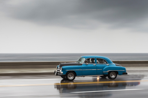Car On Road Against Sea And Cloudy Sky - gettyimageskorea