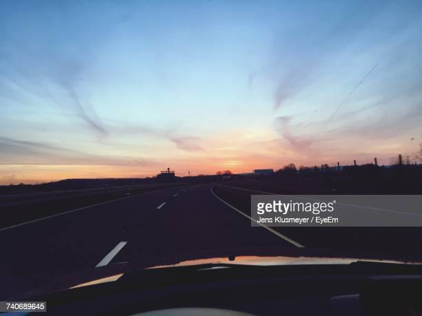 Car On Road Against Sky During Sunset