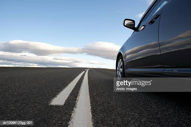 car on road in non-urban setting - generic location stock pictures, royalty-free photos & images