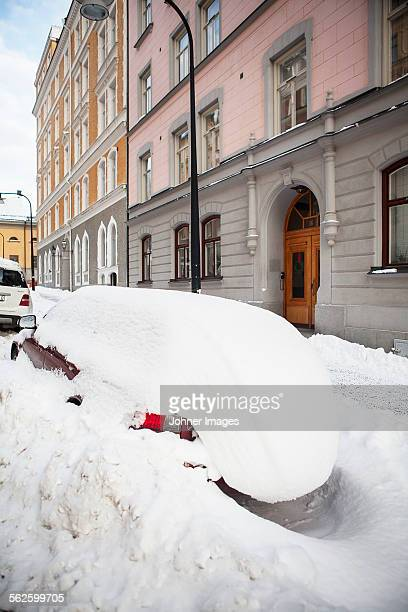 Car on street covered by snow