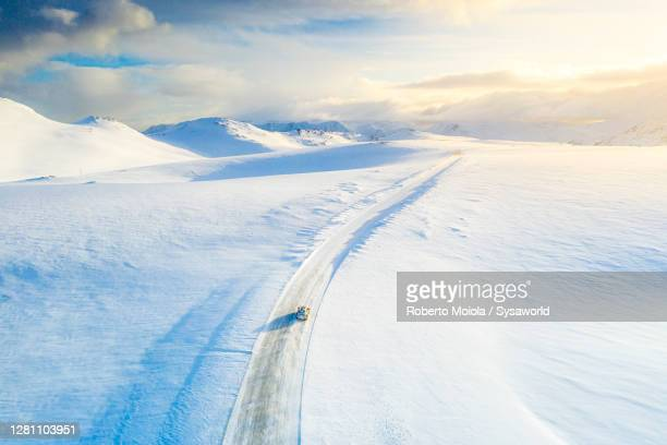 car on the snowy road towards nordkapp, finnmark, norway - 4x4 stock pictures, royalty-free photos & images