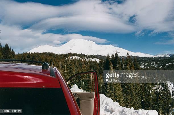 Car Overlooks Snowy Mountains