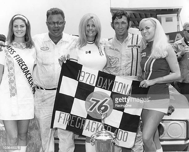 Car owner Banjo Matthews and driver Donnie Allison celebrate their victory in the Firecracker 400 at Daytona International Speedway