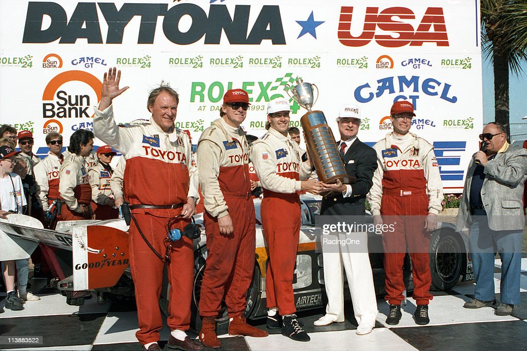 Car owner Dan Gurney (L) waves to the crowd as he celebrates his team's victory in the Rolex 24 at Daytona. Joining Gurney in victory lane at Daytona International Speedway are his drivers Rocky Moran, P.J. Jones, and Mark Dismore. The trio was driving an Eagle-Toyota MK