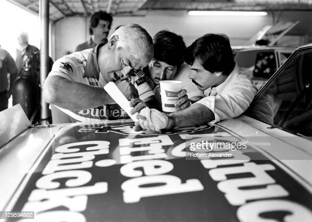 NASCAR car owner Junior Johnson left gives advice to his car's driver Neil Bonnett center and Bonnett's crew chief Jeff Hammond in the Daytona...