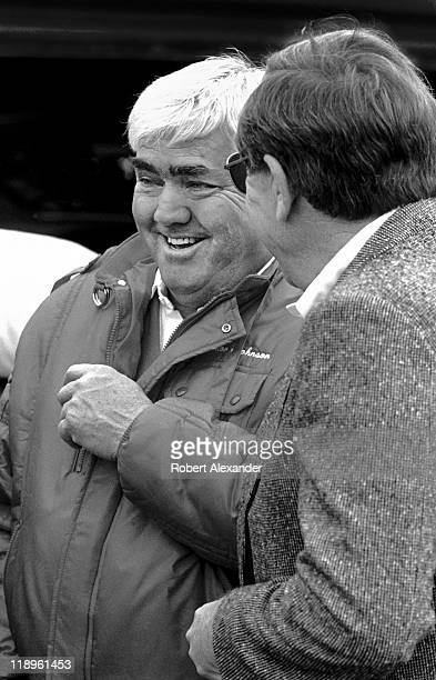 NASCAR car owner Junior Johnson left talks with NASCAR CEO Bill France Jr in the Daytona International Speedway garage area prior to the start of the...