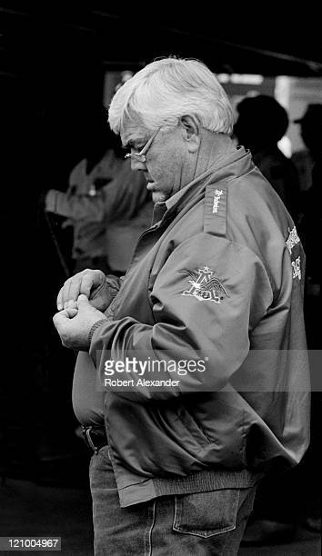 NASCAR car owner Junior Johnson pauses in the garage at the Daytona International Speedway prior to the 1987 Daytona 500 on February 15 1987 in...