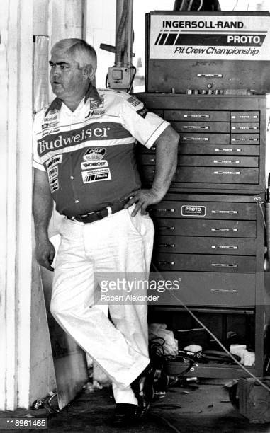 NASCAR car owner Junior Johnson relaxes in the Daytona International Speedway garage during a practice session for the 1984 Daytona 500 on February...