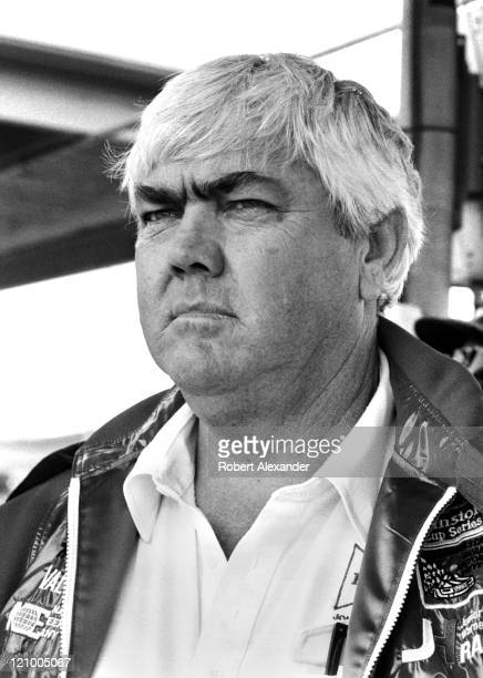 Car owner Junior Johnson watches from the pits at the Daytona International Speedway as cars qualify for the 1983 Daytona 500 on February 19 1983 in...