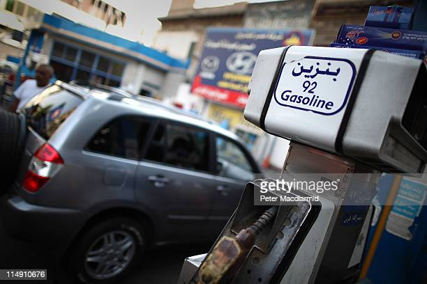 A car owner waits for workers pump fuel at a government owned petrol station on May 28 2011 in Cairo Egypt Protests in January and February brought...