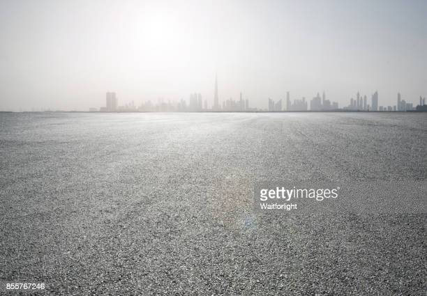 Car park with Dubai skyline background