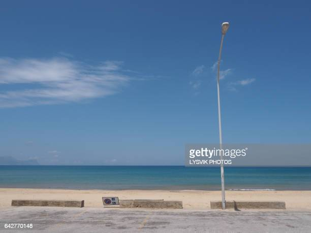 car park with street light at beach - parking sign stock photos and pictures
