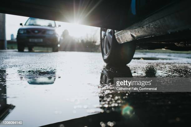 car parked in a puddle - wet stock pictures, royalty-free photos & images