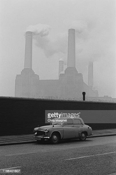 A car parked in a street with Battersea Power Station in the background London 28th December 1966