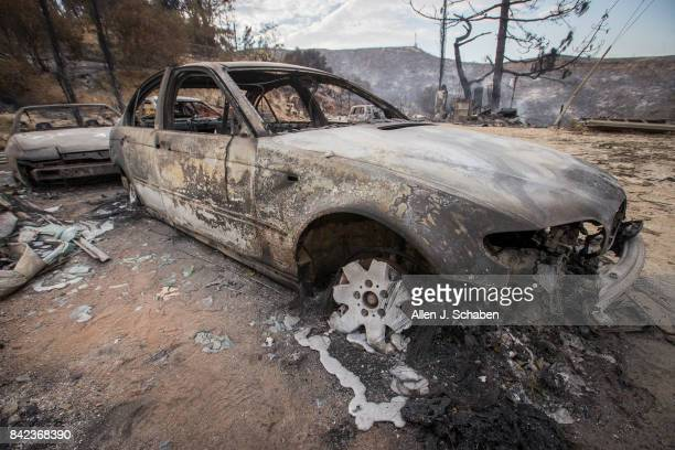 LOS ANGELES CALIF SUNDAY SEPT 3 2017 A car parked in front of a home lies in ruin as it was one of three homes and a shed were destroyed in the the...