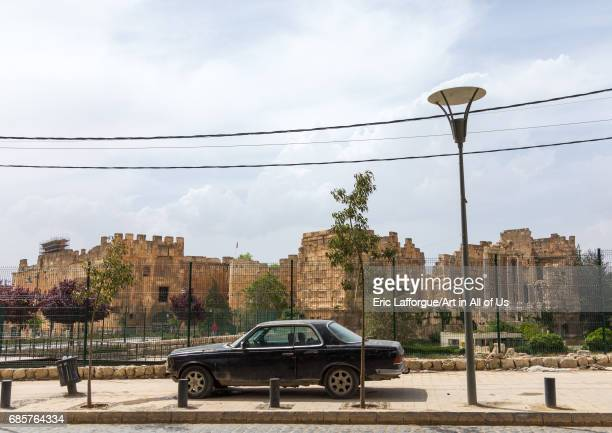 Car parked in front of the antique ruins at the archeological site Beqaa Governorate Baalbek Lebanon on May 1 2017 in Baalbek Lebanon