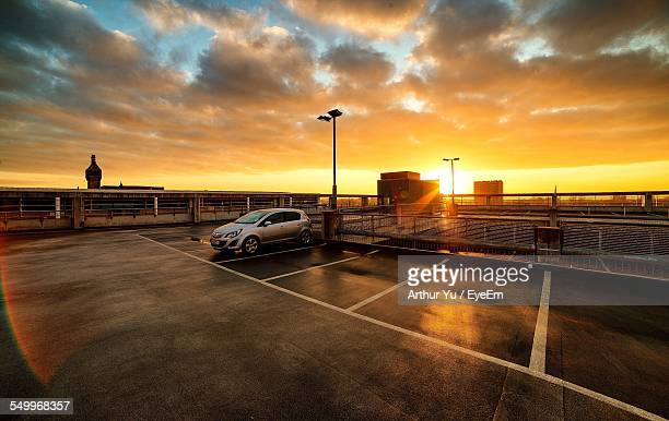 Car Parked In Parking Lot Against Cloudy Sky