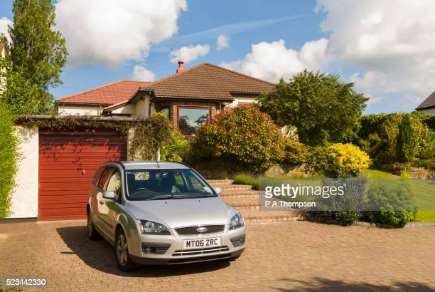 Car parked on house driveway